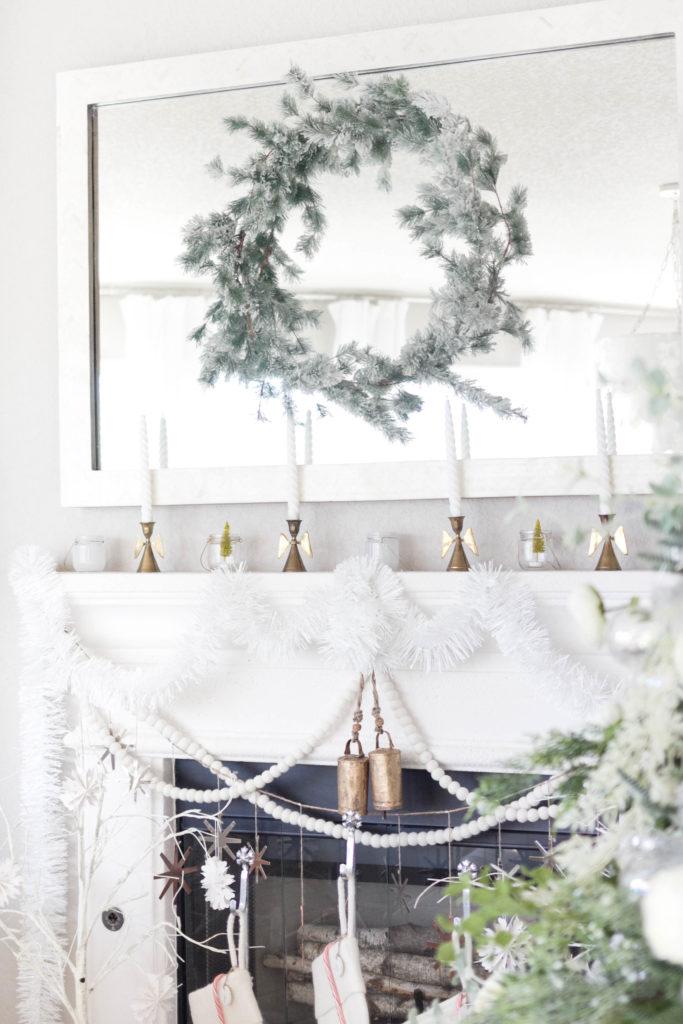 winter fireplace decorations-bohemain-glam-christmas-home-tour-iris-nacole-living-room-tourwinter fireplace decorations-felt stockings-bohemain-glam-christmas-home-tour-iris-nacole-living-room-tour