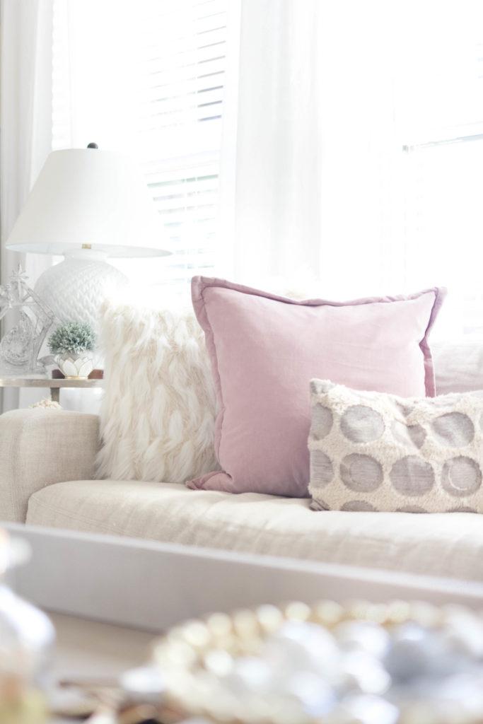 cozy mix of throw pillows-bohemain-glam-christmas-home-tour-iris-nacole-living-room-tour