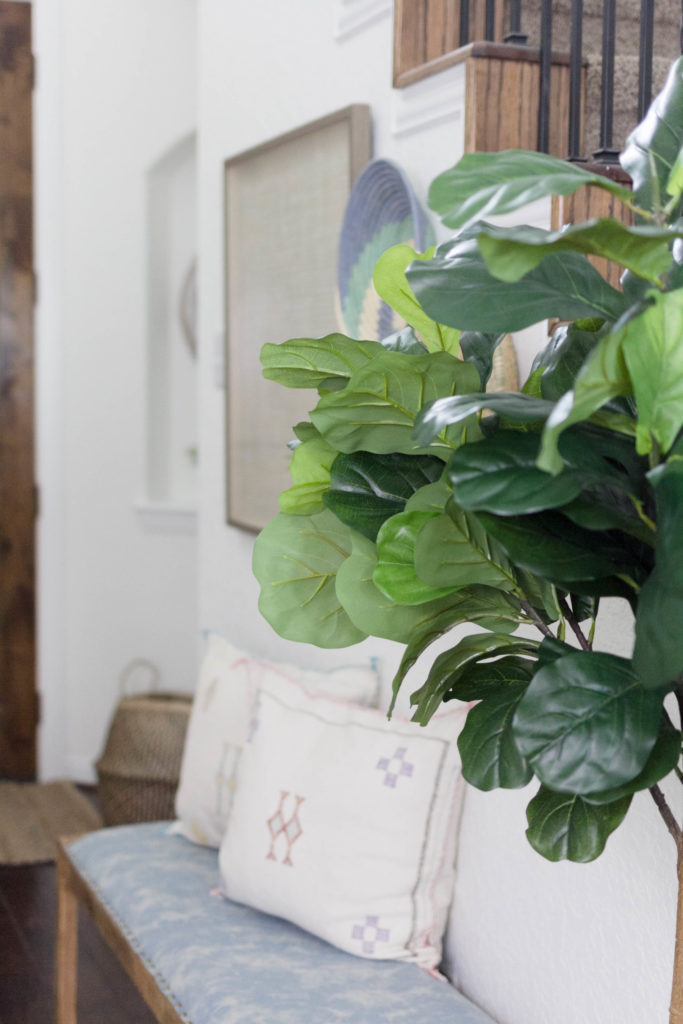 faux fiddle leaf fig tree in entryway by