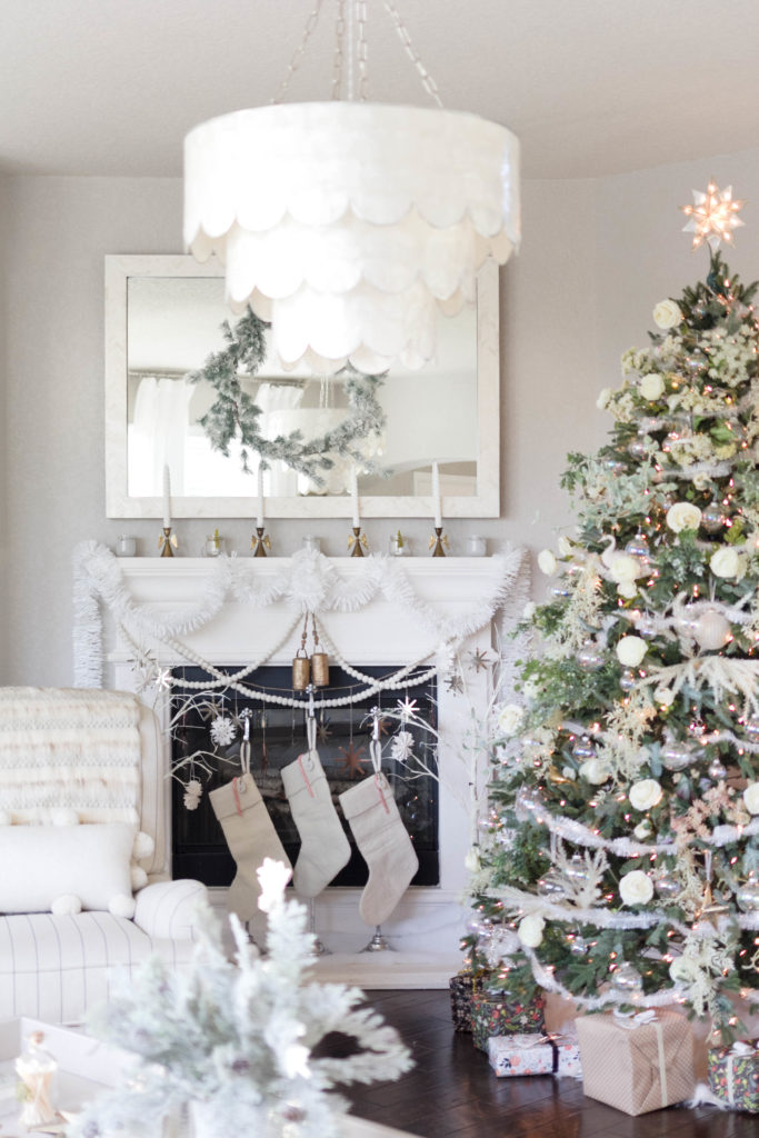 winter fireplace decorations-floral christmas tree-bohemain-glam-christmas-home-tour-iris-nacole-living-room-tour