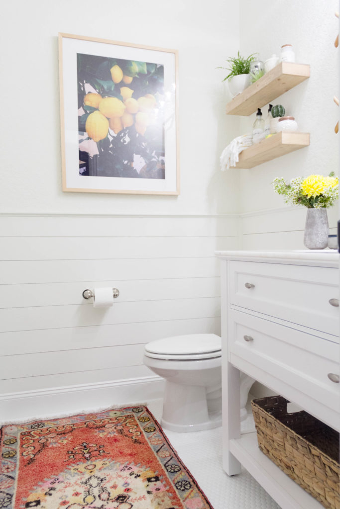 A bright and welcoming mudroom/powder room combo with a modern-casual-beach feel. Designed by: IrisNacole.com